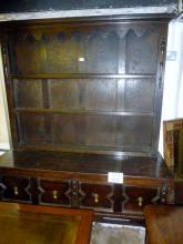 A late Victorian oak geometric dresser with two deep drawers and turned legs and stretcher est: £55-£85