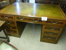 A 20c mahogany and walnut pedestal writing desk with a tooled & gilded green leather top (very clean) est: £500-£700