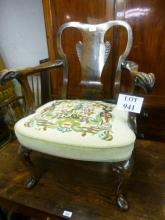 A 1920 walnut elbow chair with hand needlework upholstered seat est: £70-£90
