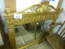 A 20c gold carved over mantel mirror with bevelled glass and ornate detailing est: £80-£100