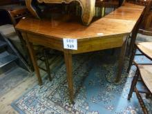 A late 18c/19c mahogany dining table with one centre section over square tapering legs and casters est: £300-£400