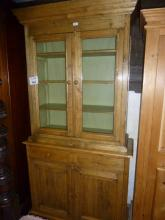 A 19c pale oak bookcase dresser with glazed top over two drawers and cupboards est: £100-£200