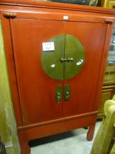 A fine late 19c/20c red lacquered cupboard with two doors and brass escutcheons (TBL4) est: £90-£120