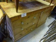 A 19c pine dresser base with three drawers and a cupboard est: £80-£120