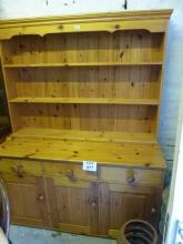 A 20c pine dresser with plate rack above three drawers and cupboards est: £100-£150