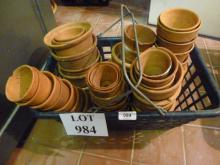 A collection of old terracotta flower pots in a basket (approx 50) est: £40-£60