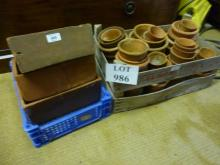 A wooden crate with old terracotta flower pots and three square terracotta pots est: £40-£60