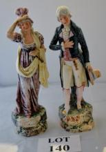 A pair of continental glazed figures of an 18c gentleman and lady est: £50-£80 (B6)