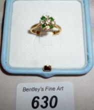 An 18ct gold diamond and emerald cluster ring (size N) boxed est: £250-£350
