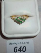 An 18ct gold ring inset with bands of emeralds and diamonds (size S) boxed est: £150-£250