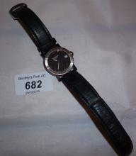 A gentleman's wristwatch with leather strap marked Raymond Weil Geneve est: £65-£85