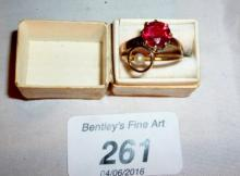 An 18ct gold cultured pearl ring (size J) and another ring with red stone (size N) boxed est: £50-£80