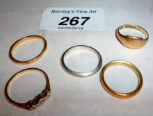 A platinum wedding ring, two 22ct gold wedding rings, a 9ct gold signet ring and an 18ct gold & diamond ring est: £100-£150