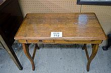 A pretty Arts & Crafts oak child's desk with a small drawer and pull out slide est: £50-£80