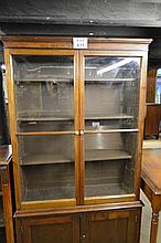 A large 19c mahogany bookcase with adjustable shelves over double cupboards est: £80-£120