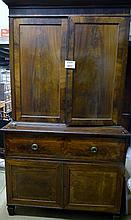 A 19c mahogany secretaire bookcase with adjustable shelves over a pull out writing drawer and cupboards beneath est: £150-£300