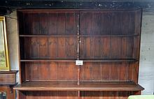 A late 19c/20c stained pine large open bookcase (6' 6'' high x 5' wide approx) est: £100-£200