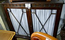 An Edwardian mahogany glazed bookcase with double doors and material backing est: £35-£45