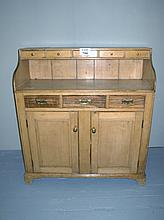 A fine Victorian pine low dresser with five small drawers above three drawers and cupboards beneath est: £200-£400