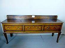 A fine rich 18c oak dresser base with three deep drawers over pad feet of good rich colour and patina est: £650-£850