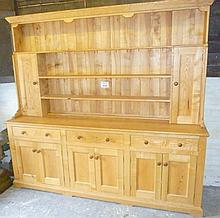 A large Bespoke ash dresser with boarded plate rack and cupboards over three drawers and four cupboard doors (7' 6'' long x 7' high approx) very good quality est: £200-£400