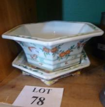 A Chinese poly chrome plant pot and stand est: £25-£45 (B35)