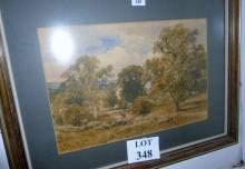 A late 19c/20c framed and glazed watercolour country landscape wit figure riding home est: £50-£80