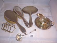 An assortment of items to include two silver backed hair brushes and a toast rack est: £25-£45