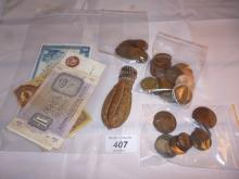 A collection of old English coins and notes to include a Georgian penny 1807, William & Mary coin, Victorian money, a bag of farthings and a sovereign purse est: £40-£60