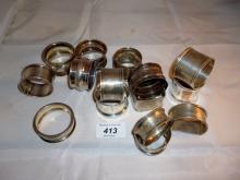 A collection of fifteen silver napkin rings all fully hallmarked est: £150-£180