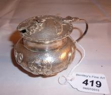 A Chinese white metal mustard pot decorated with lotus flowers est: £80-£120