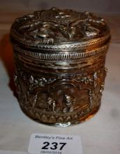 A white metal Indian trinket box embossed with panels of figures est: £100-£120