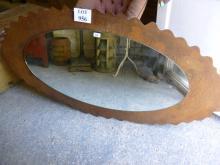 A metal framed wall mirror est: £40-£60