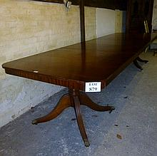 A large late 20c extending dining table in mahogany with three leaves (slightly a/f) est: £100-£200