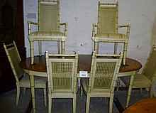 A mid-late 20c dining table and six cane back chairs painted and with bamboo design legs est: £80-£120