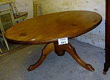 A large pine round kitchen/dining table with turned column and triple splayed legs est: £100-£150