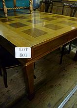 A c1900 oak dining table with panelled top over a deep frieze and square tapering legs est: £100-£200