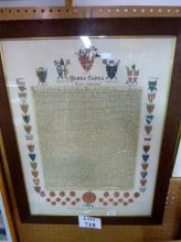 A framed and glazed facsimile Magna Carta by Express Permission from the original document in the British Museum, with the Seals of the King's Securities and Shields of ye Barons in Arms,  72 cm x 54 cm est: £30-£50