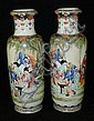 Pair of hand painted Oriental porcelain vases