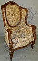 Carved wing back chair with swan head arms