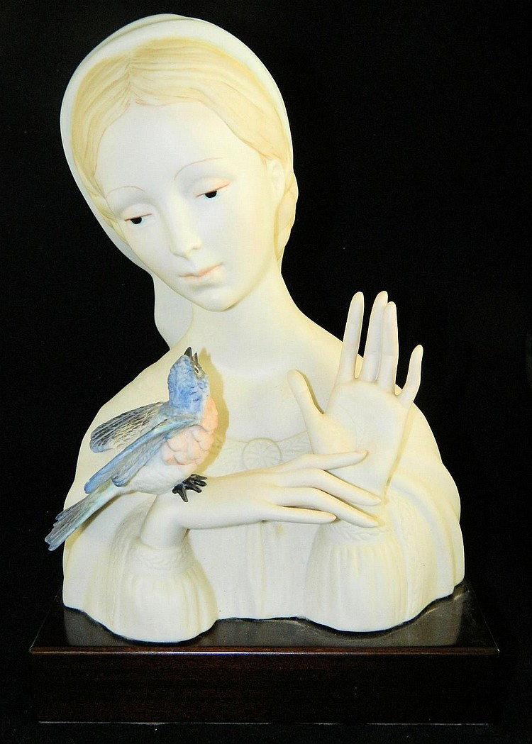 Cybis head bust of girl with bird on wooden base