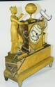 Figural gilt metal mantle clock
