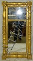 Mirror in carved gilt frame