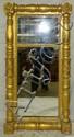 Mirror in carved gilt frame