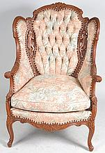 Upholstered Arm Chair with Figural Carvings