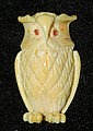 Ivory carved owl with red jeweled eyes