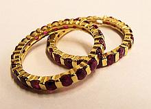 Two 10k Gold And Ruby Bands