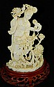Oriental ivory carving of woman with flowers