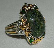 Sterling Silver Ring with Green Stones
