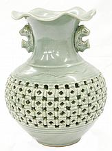 Celadon Vase with cutwork, fish handles